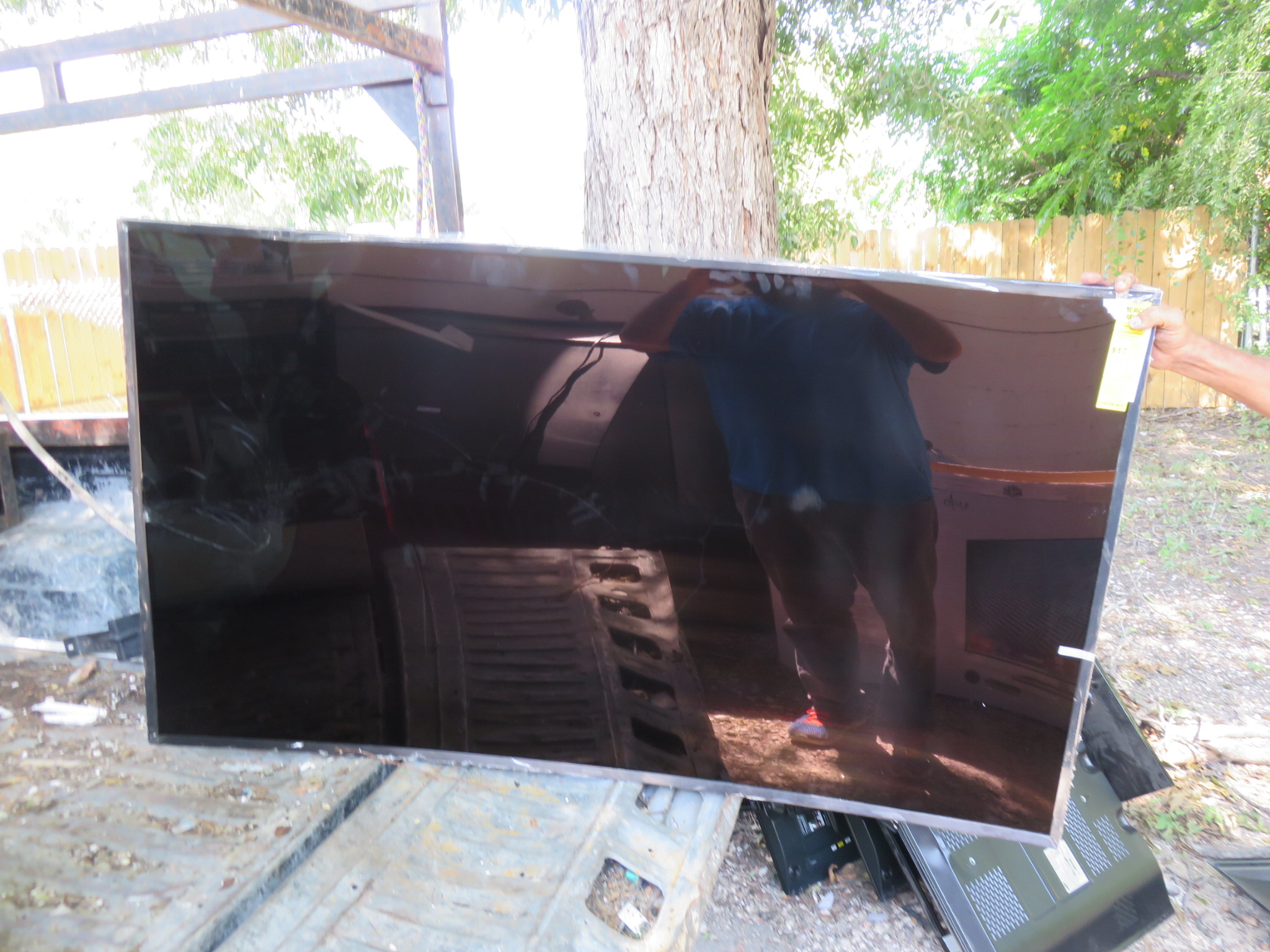 Broken led lcd plasma tv screen recycling broken curved led tv in the back of of truck getting ready for recycling aloadofball Image collections