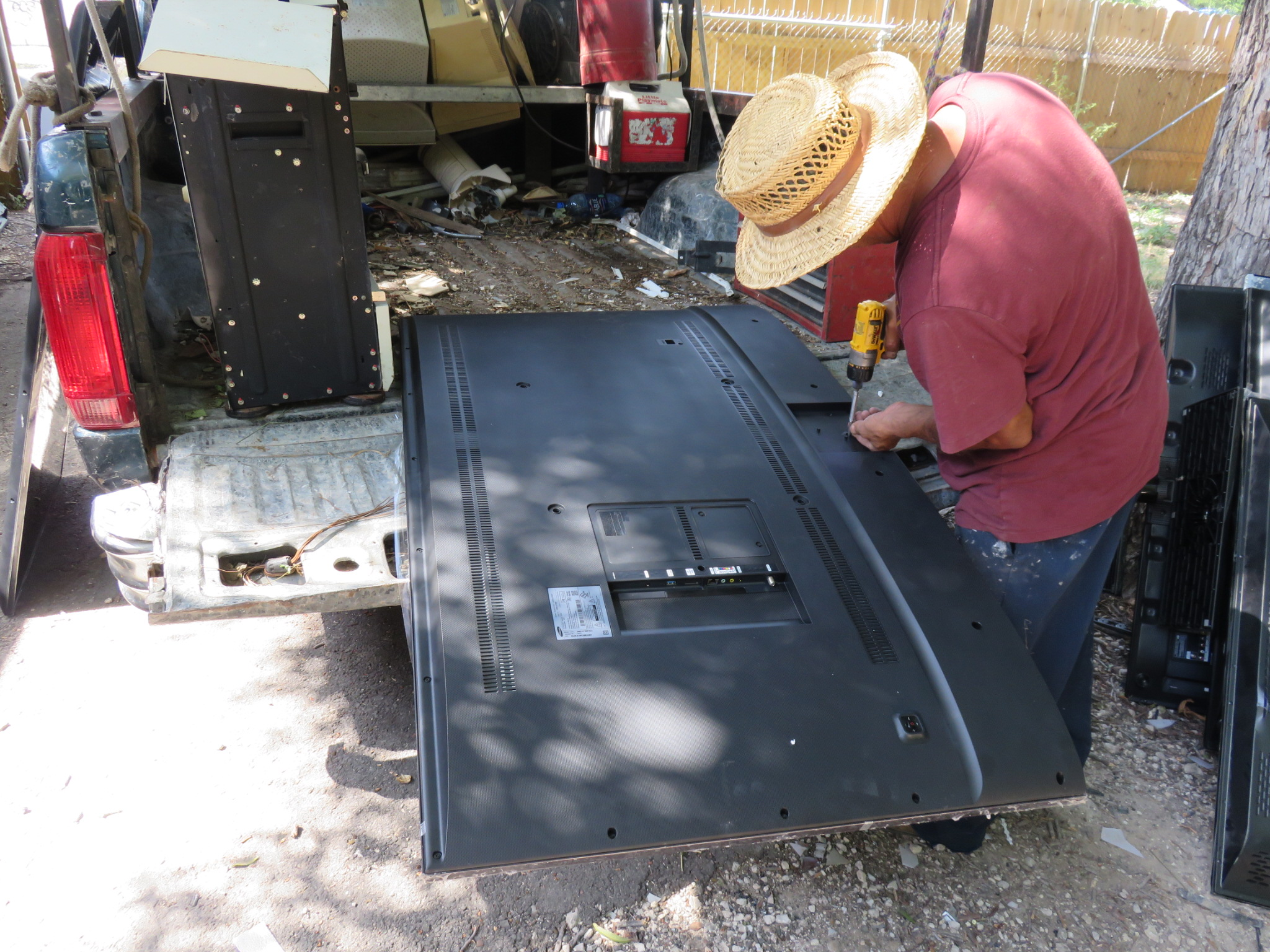 Richard taking a curved TV apart for recycling
